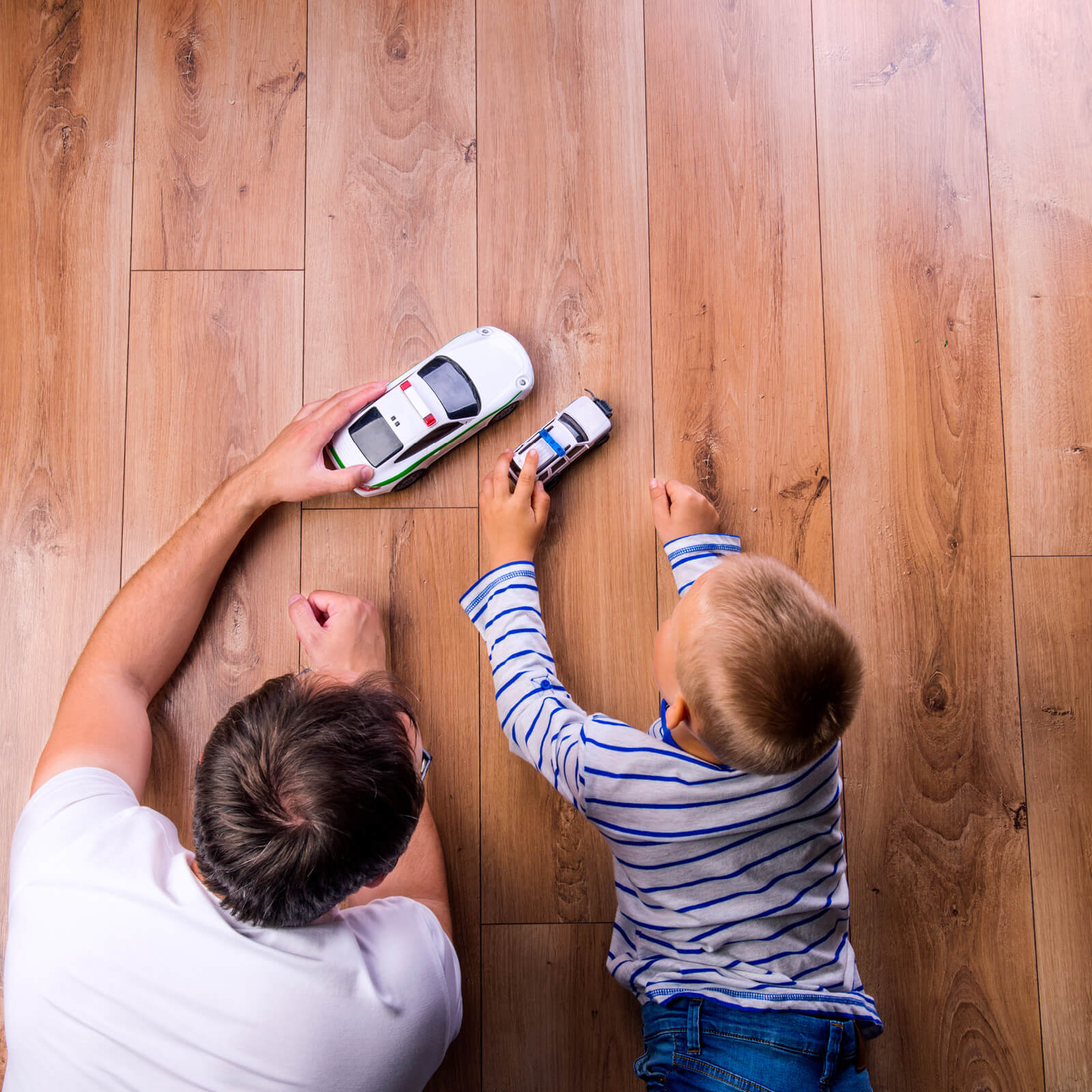 Father and kid playing with toycar | Webb Carpet