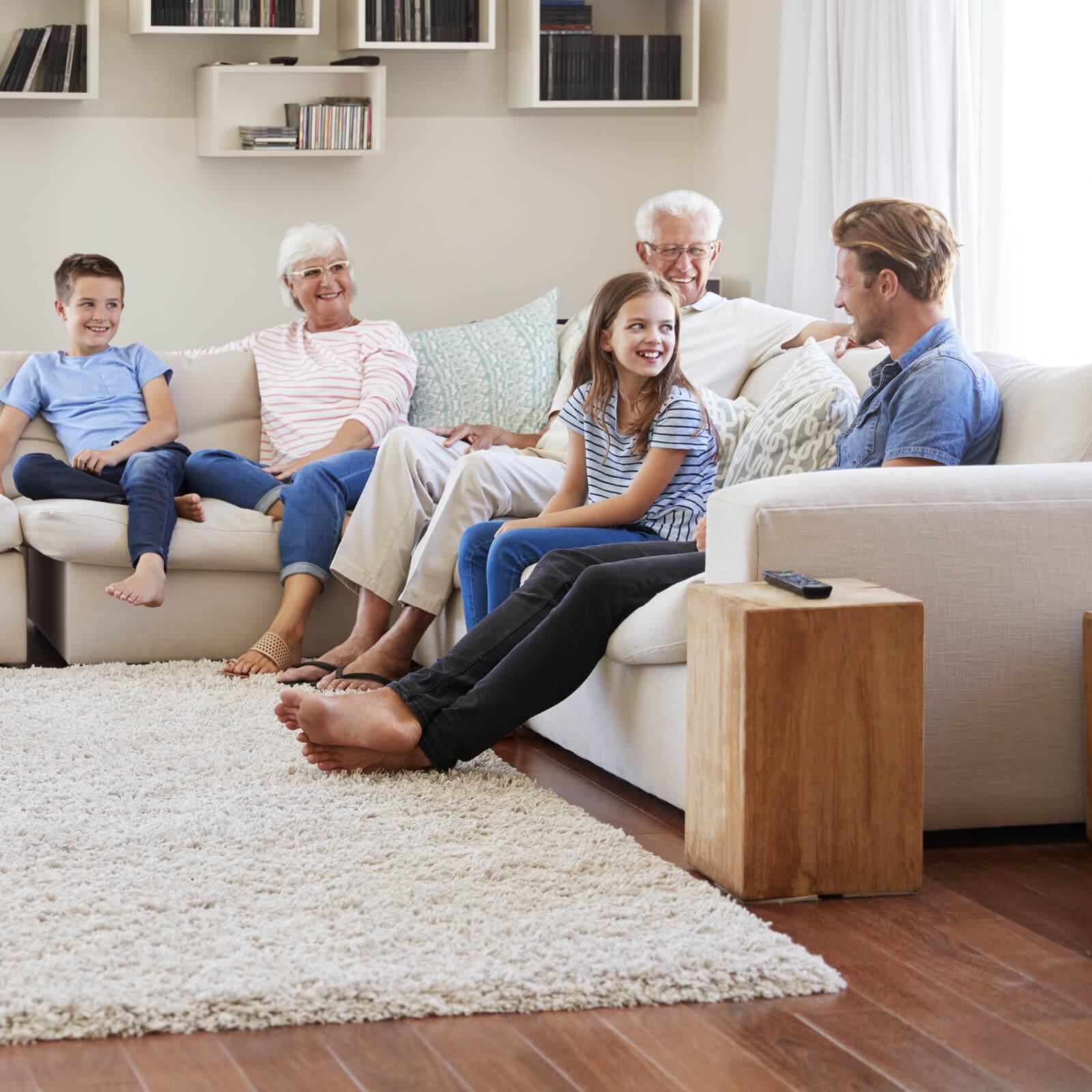 Family gosping in living room | Webb Carpet